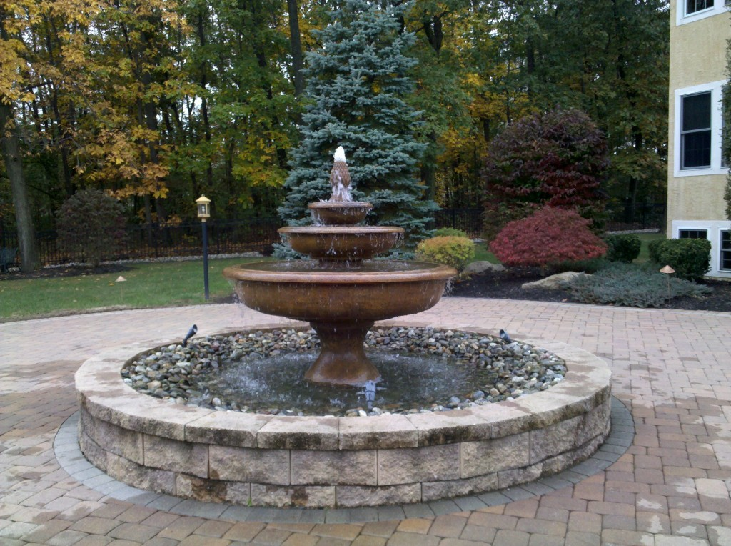 Water features and koi ponds sycamore landscaping inc for Koi pond fountain